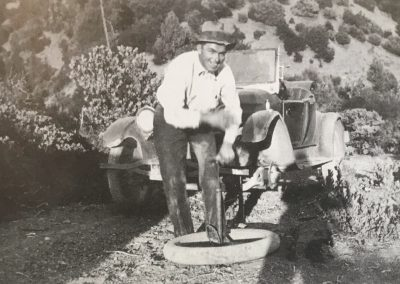Charlie Krenkel changing a tire c. 1930